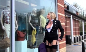 naughty-blonde-milf-in-lingerie-flaunts-her-curves-in-public