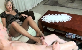 pantyhosed-mature-lady-shows-off-her-great-footjob-abilities