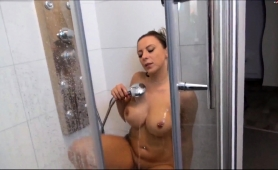 big-breasted-blonde-mom-pleases-her-snatch-in-the-shower
