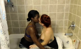 interracial-lesbian-friends-kiss-each-other-in-the-bathtub