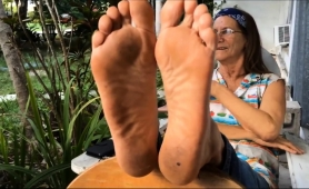 naughty-granny-with-glasses-shows-off-her-lovely-feet