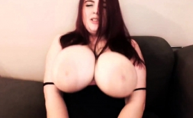 stunning-brunette-shows-off-her-huge-breasts-and-masturbates