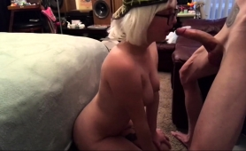 buxom-blonde-with-glasses-kneels-down-and-gives-a-blowjob