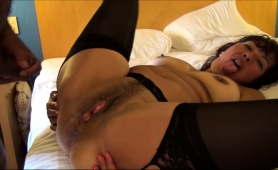 curvy-milf-in-stockings-lies-on-the-bed-and-gets-fucked-hard