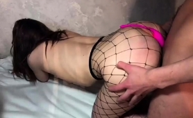 sexy-brunette-in-fishnet-pantyhose-gets-drilled-doggystyle