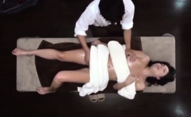 striking-oriental-babe-gets-nailed-hard-on-the-massage-table