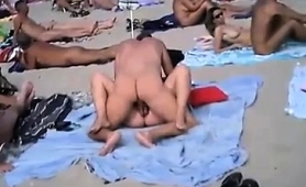 horny-mature-wife-having-sex-with-her-lover-on-the-beach
