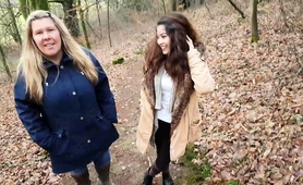blonde-mom-and-brunette-teen-give-a-double-blowjob-outside