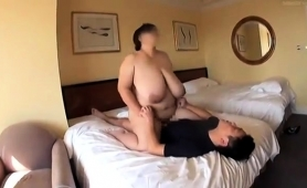 huge-breasted-oriental-lady-enjoys-a-wild-ride-of-fucking
