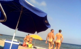 nudist-beach-voyeur-shoots-a-sexy-mature-lady-with-big-boobs