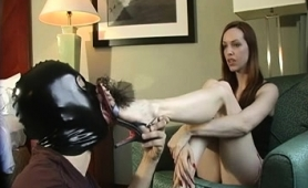 dominant-brunette-milf-has-a-masked-slave-licking-her-toes