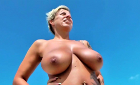 bodacious-blonde-cougar-shows-off-her-sexy-body-on-the-beach